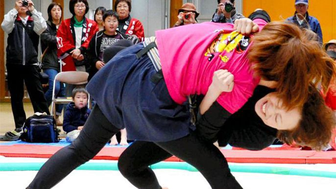 Female sumo wrestlers grapple at Okayama event