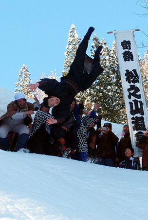 Newly married men hurled into snow during Niigata festival