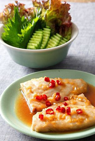 Wrap up, enjoy fish cooked Vietnamese style