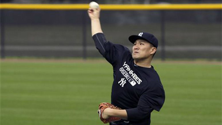 Baseball: Tanaka reports to camp, plays long toss