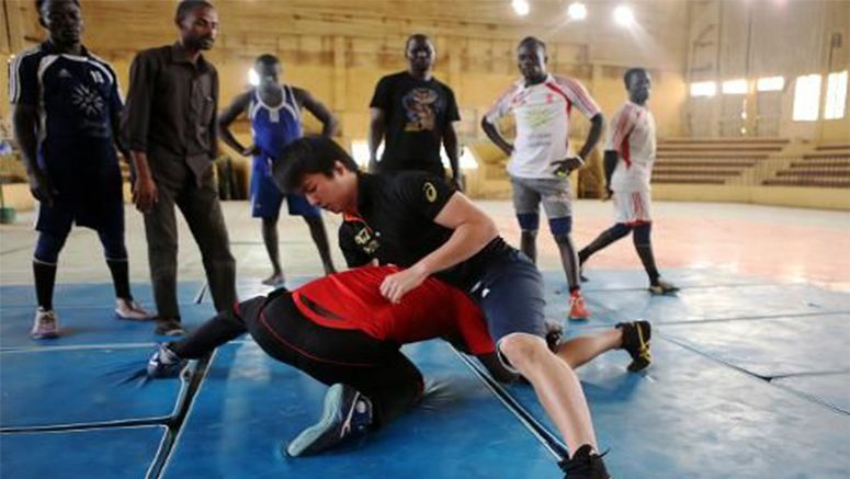 Japanese coach prepares Sudan wrestlers for Olympics