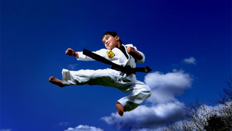 Tiny six-year-old karate kid breaks world record with 2nd degree black belt