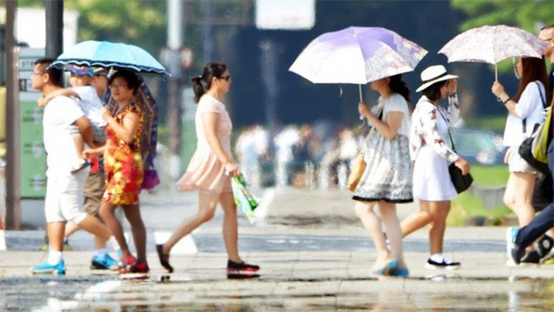 Photo : Tokyo marks record-breaking hot spell 2015