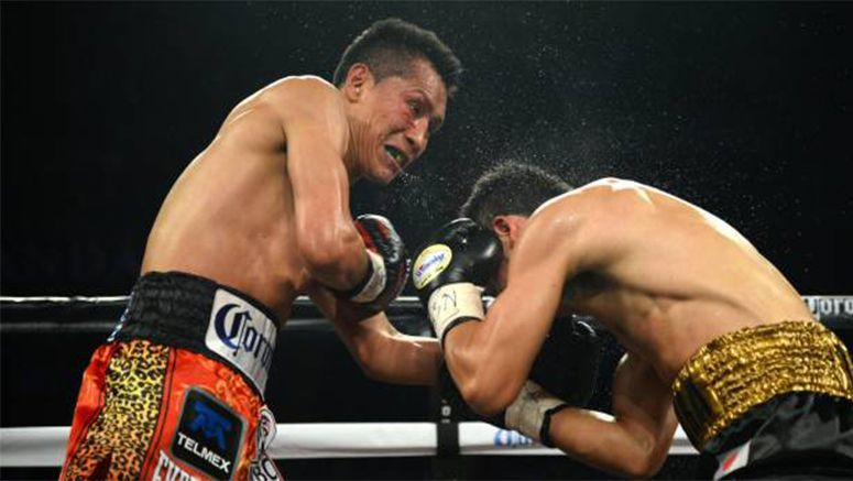 Boxing : Vargas stops Miura in 9th for WBC title