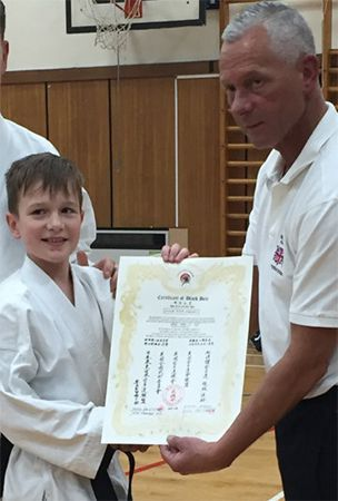 Young karate student awarded black belt after 'outstanding performance'