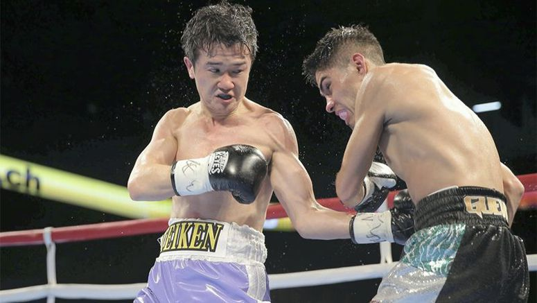 'Salaryman' boxer becomes world champ