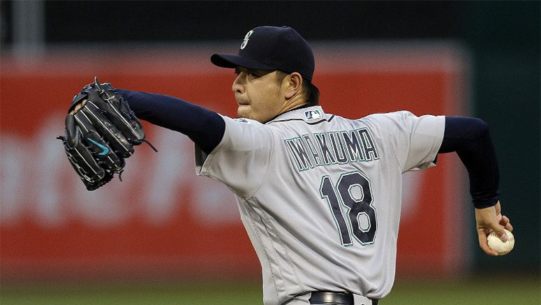 MLB: Iwakuma battles to earn 1st win