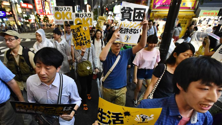 Hundreds join protest against online bashing of poor in downtown Tokyo