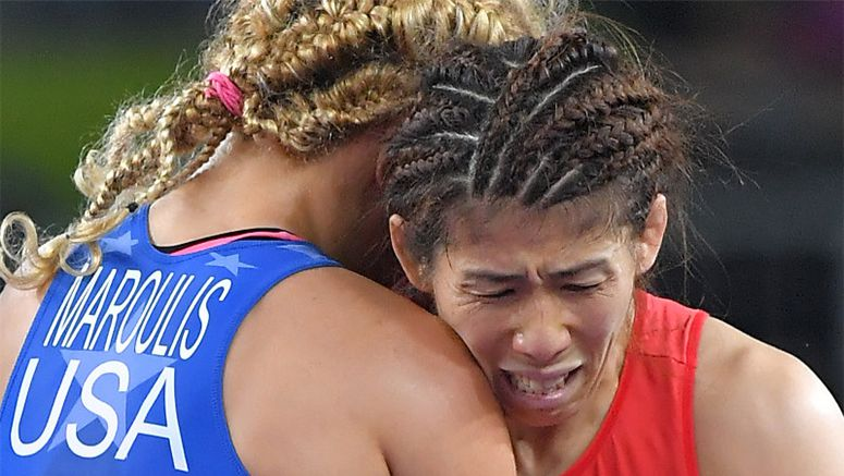 Yoshida left in tears after shock Olympic defeat, says sorry for loss