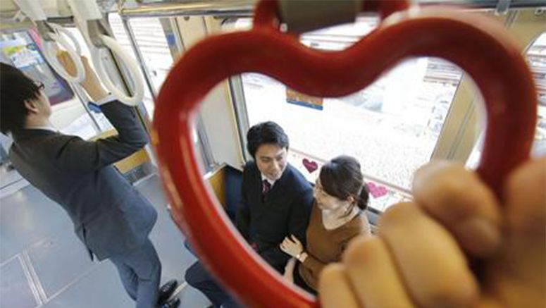 "Tokyo railway starts running ""love train"" with heart-shaped straps"