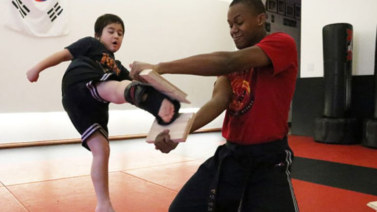 Young karate instructor brings joy to his students