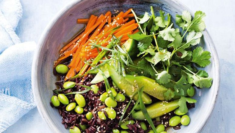 Edamame and dark rice serving of mixed greens
