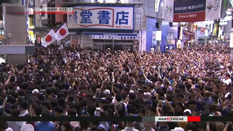 Soccer fans elated at Japan's win over Colombia