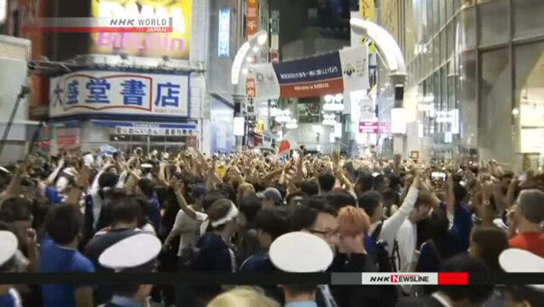 Euphoric soccer fans clog Shibuya intersection