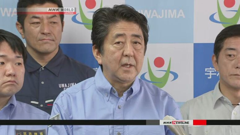 Abe pledges review of dam warning system
