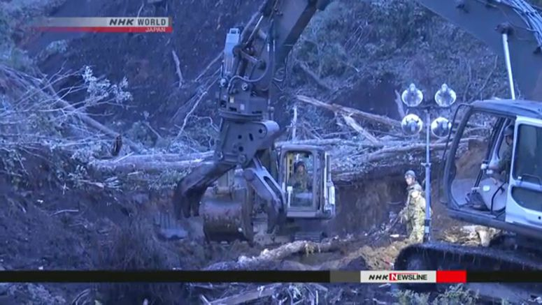 Rescuers look for survivors in rubble and mud