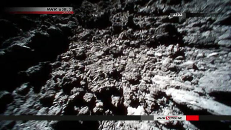 JAXA releases images sent from asteroid rovers