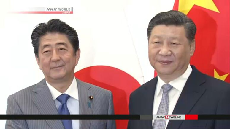Abe, Xi agree to improve relationship