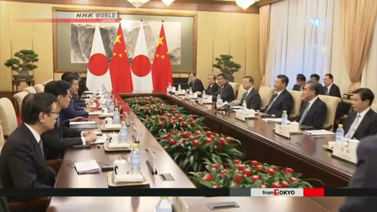 Abe, Xi agree to boost ties