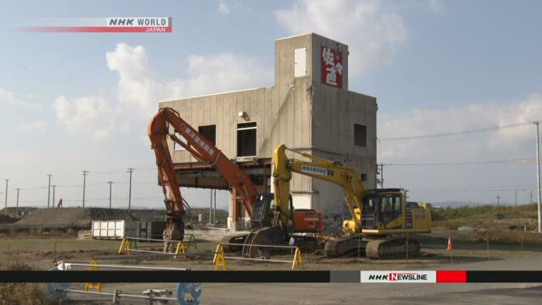 Survivors sad about tsunami-hit factory demolition