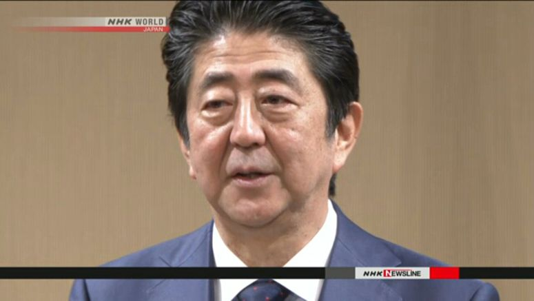 Abe vows independent probe of data scandal