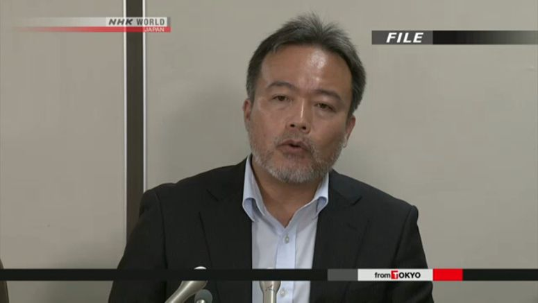 Japanese journalist ordered to hand over passport