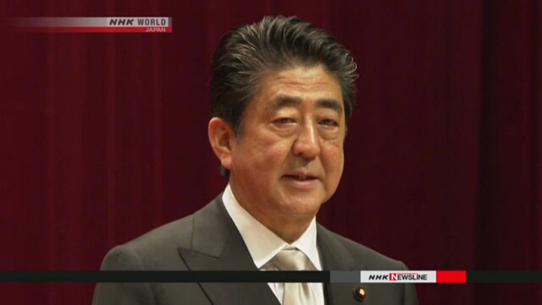 Abe calls for eradicating child abuse