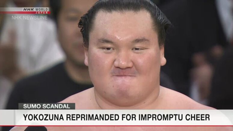 Hakuho reprimanded for hand-clapping cheer