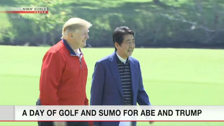 Trump, Abe enjoying golf, sumo