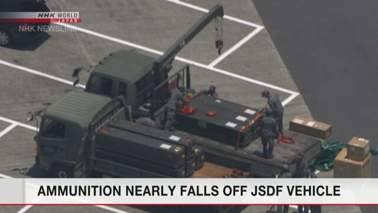 SDF truck's ammunition load comes loose