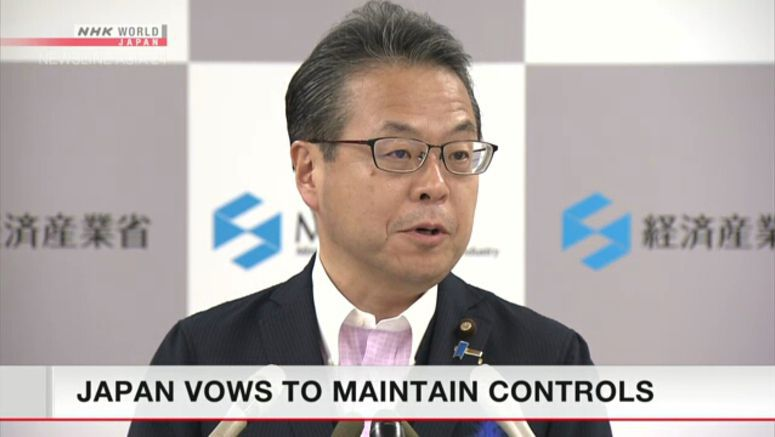 Japan vows to maintain export controls