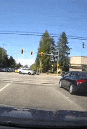 Toyota Sienna Runs Red Light In Front Of Police SUV – You Can Guess The Rest