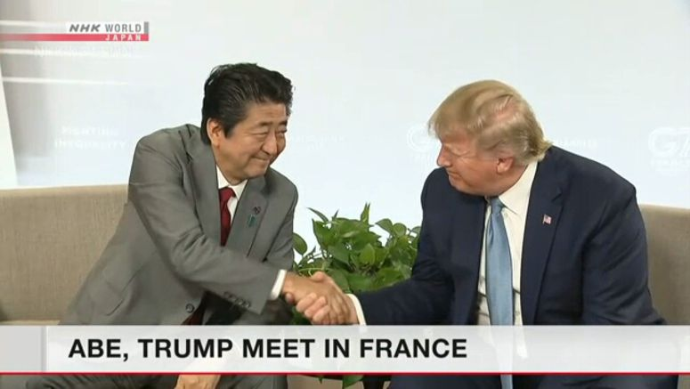 Abe, Trump hold talks in France