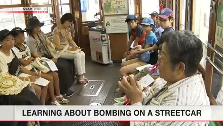 Children learn about A-bomb on streetcar