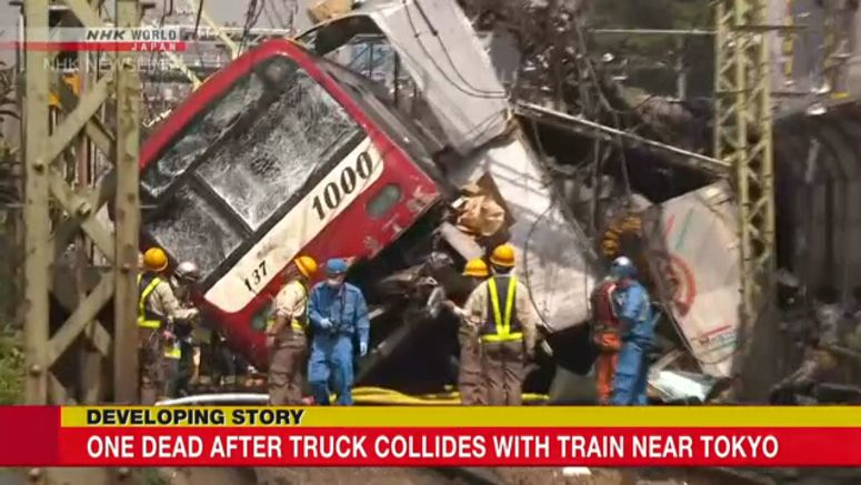 Express train collides with truck in Yokohama