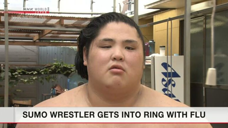 Sumo wrestler climbs into ring after flu diagnosis