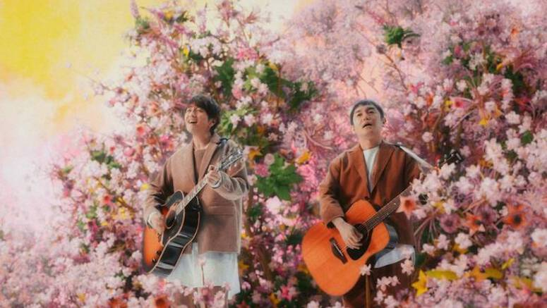 Yuzu is surrounded by flowers in PV for 'Hanasaku Machi'