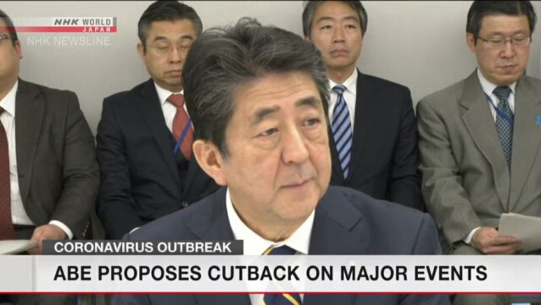 Japan PM Abe proposes cutback on major events