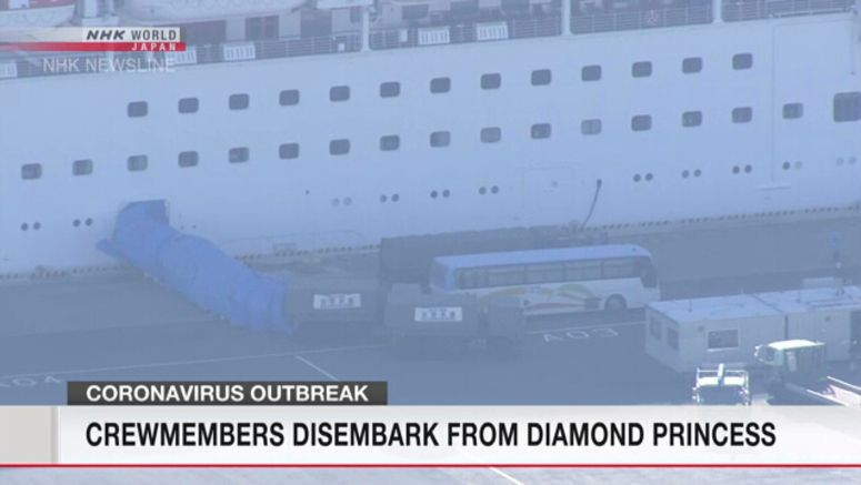 Crew members disembark from Diamond Princess