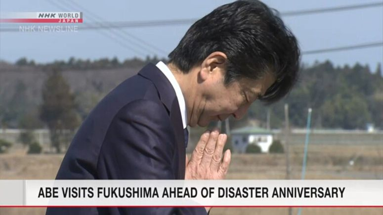 Abe visits Fukushima ahead of 9th anniversary