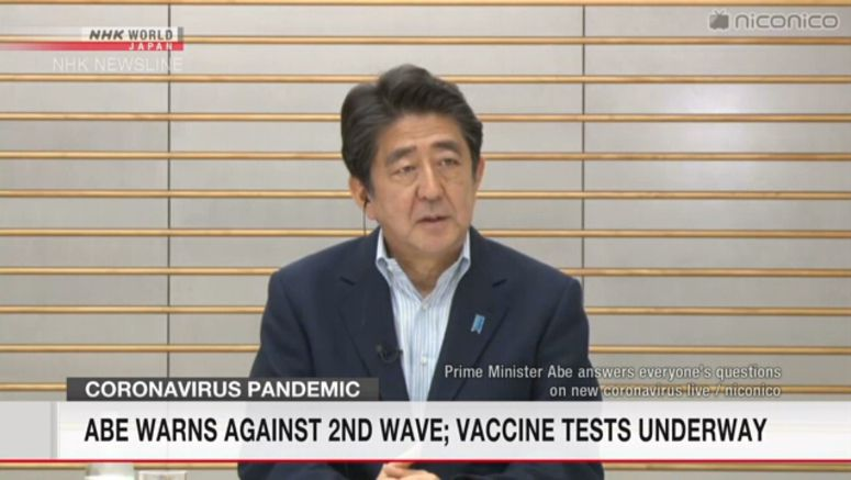 Abe warns against 2nd wave; vaccine tests underway