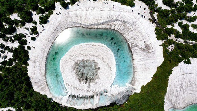 Melting snow creates gigantic 'dragon eye' on mountain