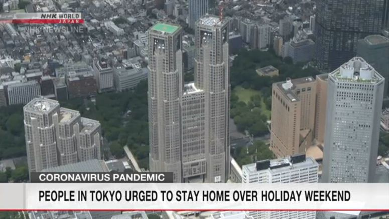 People in Tokyo urged to stay home over weekend