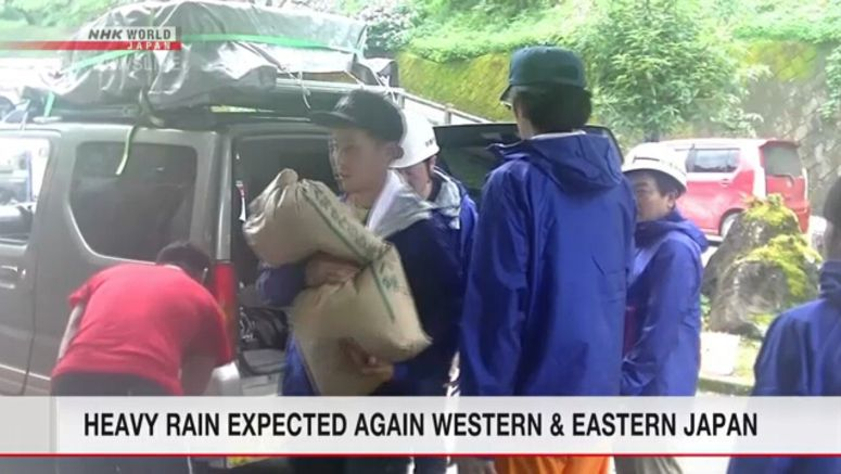 Rafting guides carry relief goods to Kuma people