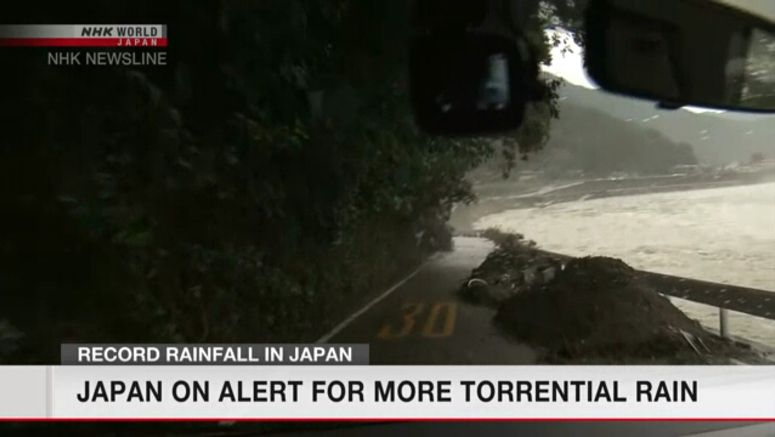 Japan on alert for more torrential rain