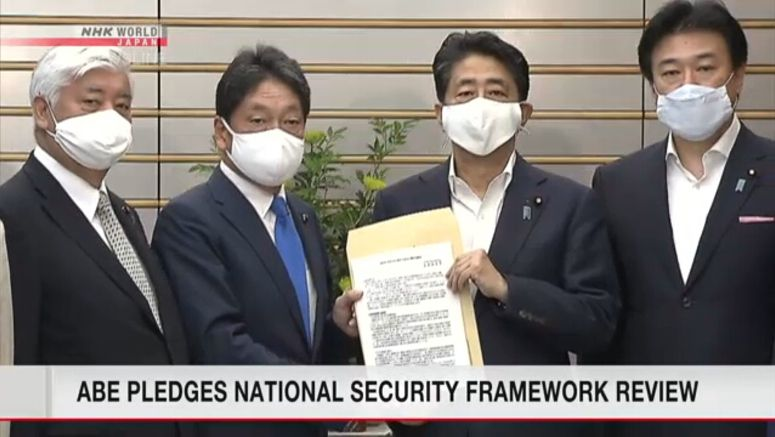 Abe calls for national security-framework review