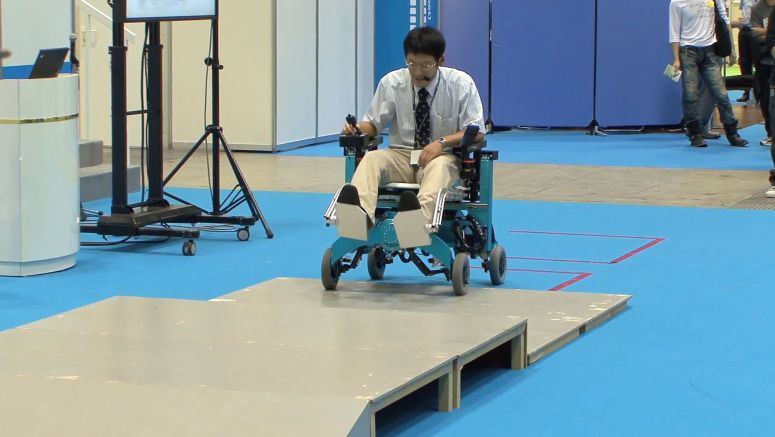 Robotic wheelchair from Chiba Tech turns wheels into legs and climbs over steps