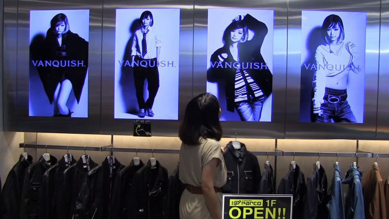Monitor Shows Model Wearing Shopper-selected Clothing in Video