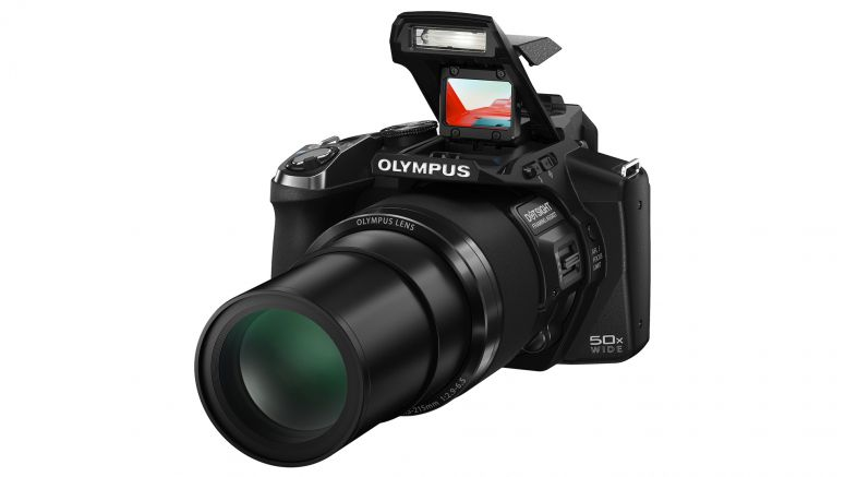 Aiming Olympus Stylus SP-100, the 50x superzoom camera with a gun sight