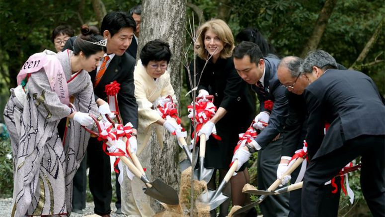 Kennedy plants tree of friendship at Ise Jingu shrine